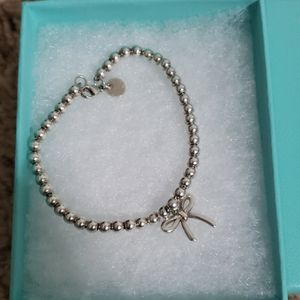 Tiffany and co bracelet with bow charm.